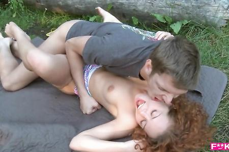 Fucks Russian slender redhead girl on the lake with a big dick